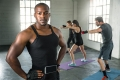 African american black male athlete trainer in workout gym for b